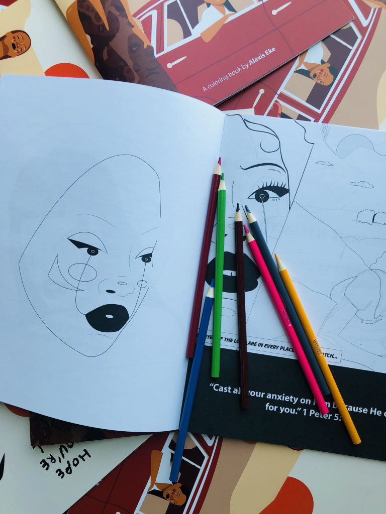 Drawings of Black women in colouring book
