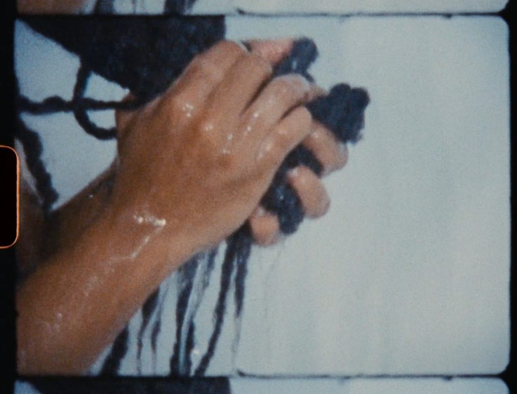 Woman holding braids